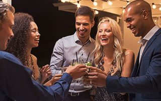 coworkers toasting at holiday party
