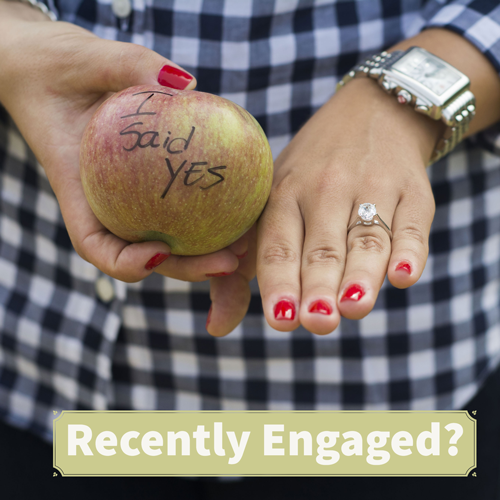 apple with message and diamond ring for engagement